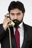 Młody biznesmen używa rocznika telefon Zdjęcie Stock