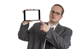 Młody biznesmen w kostiumu z pastylka komputerem Obrazy Stock
