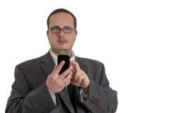 Młody biznesmen w kostiumu z telefonem komórkowym Fotografia Stock