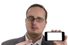 Młody biznesmen w kostiumu z telefonem komórkowym Zdjęcia Stock