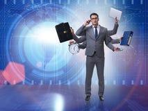 Młody biznesmen w multitasking pojęciu Zdjęcie Royalty Free