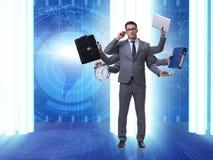 Młody biznesmen w multitasking pojęciu Obraz Royalty Free