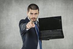 Młody biznesmen wskazuje przy tobą zdjęcia stock