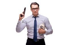 Młody biznesmen z pistoletem odizolowywającym na bielu Fotografia Royalty Free