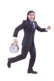 Młody biznesmen z zegarem Zdjęcia Royalty Free
