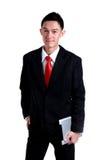 Młody biznesowego mężczyzna ono uśmiecha się odizolowywam na białym tle Zdjęcia Stock