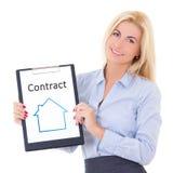Młody biznesowej kobiety agent nieruchomości pokazuje schowek z co Obrazy Stock