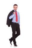 Młody biznesowy pozować na pracownianym tle Fotografia Stock