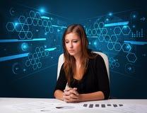 Bizneswoman robi papierkowej robocie z futurystycznym tłem Obrazy Royalty Free