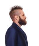 Młody brodaty mężczyzna profilu portret odizolowywający przy bielem obraz stock