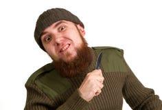 Młody brodaty mężczyzna z nożem fotografia stock