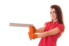 Młody brunetki kobiety budowniczy w mundurze robi odświeżaniom przyglądający i ono uśmiecha się z narzędziami w jej rękach na kam Zdjęcia Royalty Free