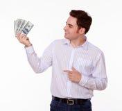Młody caucasian mężczyzna wskazuje przy pieniądze obraz royalty free