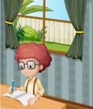 Młody chłopiec writing wśrodku domu Fotografia Royalty Free