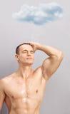 Młody człowiek bierze prysznic pod pada chmurą Obraz Royalty Free