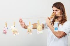 Młody człowiek choroba pieniądze fotografia stock