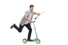 Młody człowiek jedzie hulajnoga i jest opóźniony Zdjęcie Stock
