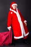Młody człowiek jest ubranym jak Santa klauzula. Zdjęcie Royalty Free