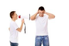 Młody człowiek krzyczy w megafon Zdjęcie Royalty Free