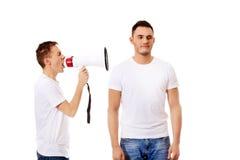 Młody człowiek krzyczy w megafon Obraz Stock