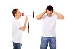 Młody człowiek krzyczy w megafon Fotografia Royalty Free