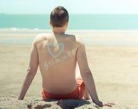 Młody człowiek na plaży Fotografia Stock