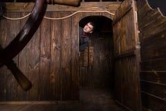 Młody Człowiek ono Przygląda się Out Od kabiny Drewniany statek Zdjęcia Stock