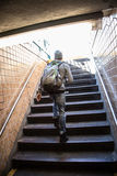 Młody człowiek opuszcza NYC stację metru Zdjęcia Stock