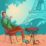 Młody człowiek pije kawę w Paryskim kontrascie Zdjęcie Stock