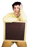 Młody człowiek pokazuje białą deskę zdjęcia royalty free