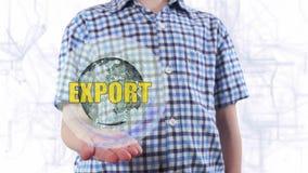 Młody człowiek pokazuje hologram planeta teksta i ziemi eksport zbiory wideo