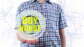 Młody człowiek pokazuje hologram planeta teksta i ziemi zakupu dom zbiory