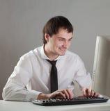 Młody człowiek przy komputerem Obrazy Stock