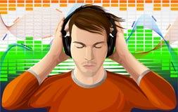 Młody człowiek słucha muzyka w hełmofonach Zdjęcia Royalty Free