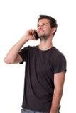 Młody Człowiek target64_0_ na telefonie obraz stock