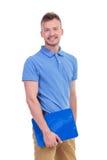 Młody człowiek trzyma schowek fotografia stock