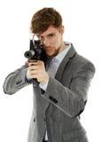 Młody człowiek używa maszynowego pistolet Zdjęcie Stock