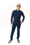 Młody człowiek w błękitów ubraniach na białym tle fotografia royalty free
