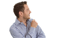 Młody człowiek w błękitny koszulowy patrzeje z ukosa odosobnionym na białym backg Zdjęcie Stock