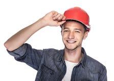 Młody człowiek w budowa hełmie Obrazy Stock