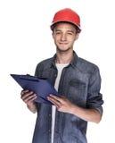 Młody człowiek w budowa hełmie Obrazy Royalty Free