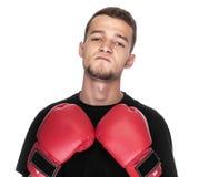 Młody człowiek w czerwonych bokserskich rękawiczkach Obraz Stock