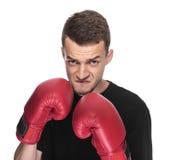 Młody człowiek w czerwonych bokserskich rękawiczkach Obraz Royalty Free