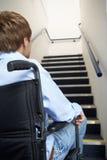 Młody człowiek w wózek inwalidzki Zdjęcie Royalty Free