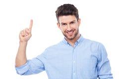 Młody człowiek wskazuje up Fotografia Royalty Free