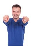 Młody człowiek wskazuje z jego palcami fotografia stock