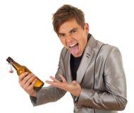 Młody człowiek z butelką piwo Zdjęcia Stock