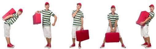 Młody człowiek z czerwoną walizką odizolowywającą na bielu fotografia stock