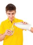 Młody Człowiek z mlekiem Zdjęcia Stock