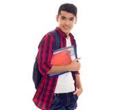 Młody człowiek z plecakiem i zeszytami Obrazy Royalty Free